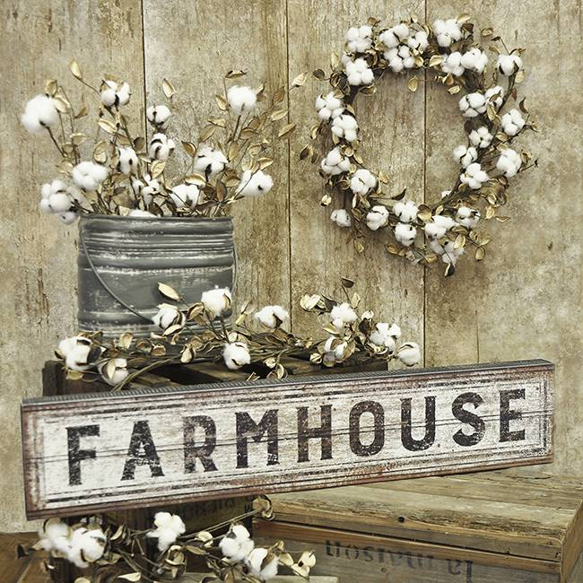 Dress up a wall with a cotton wreath or a distressed farmhouse sign