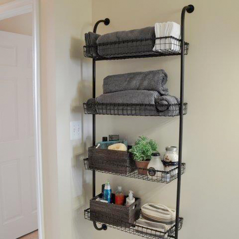 Add extra storage in your farmhouse bathroom by hanging a set of decorative shelves.